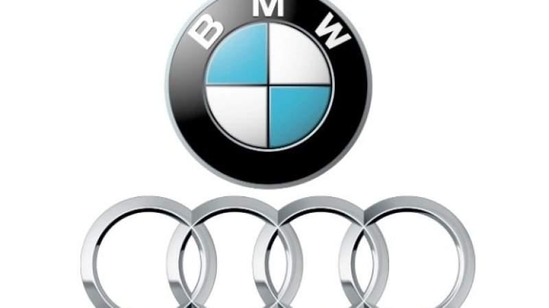 2019-Audi-Q7-vs-2019-BMW-X5-logo.jpg